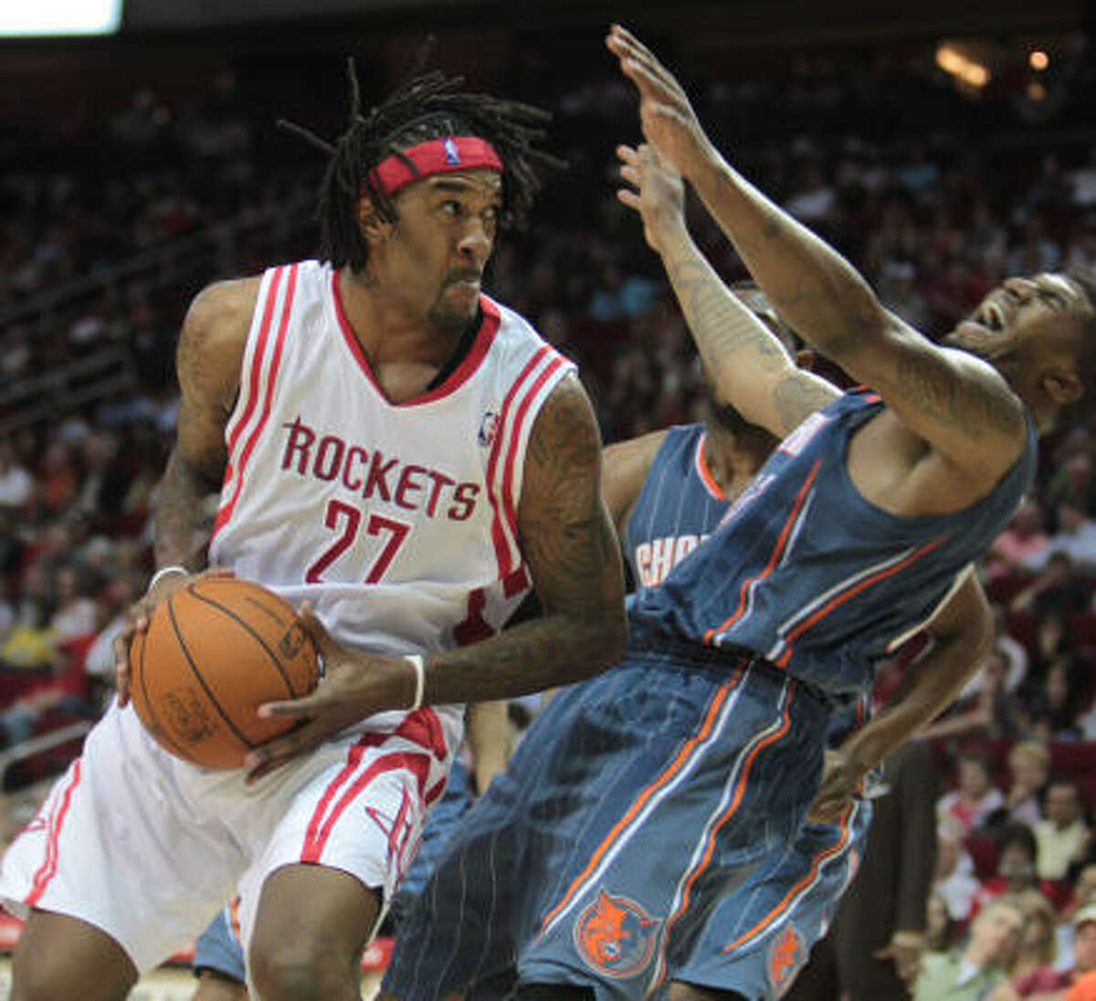 Rockets center Jordan Hill (27) gives an elbow to Bobcats forward Tyrus Thomas during the second half.