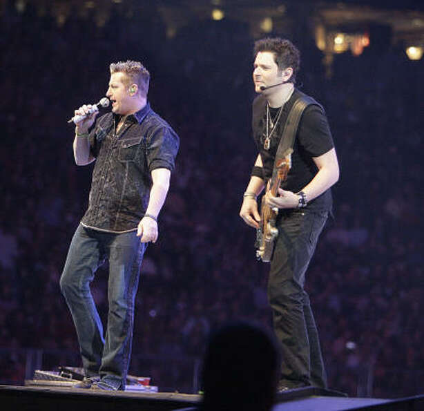 Rascal Flatts performs in concert during the Houston Livestock Show and Rodeo at Reliant Stadium Thu