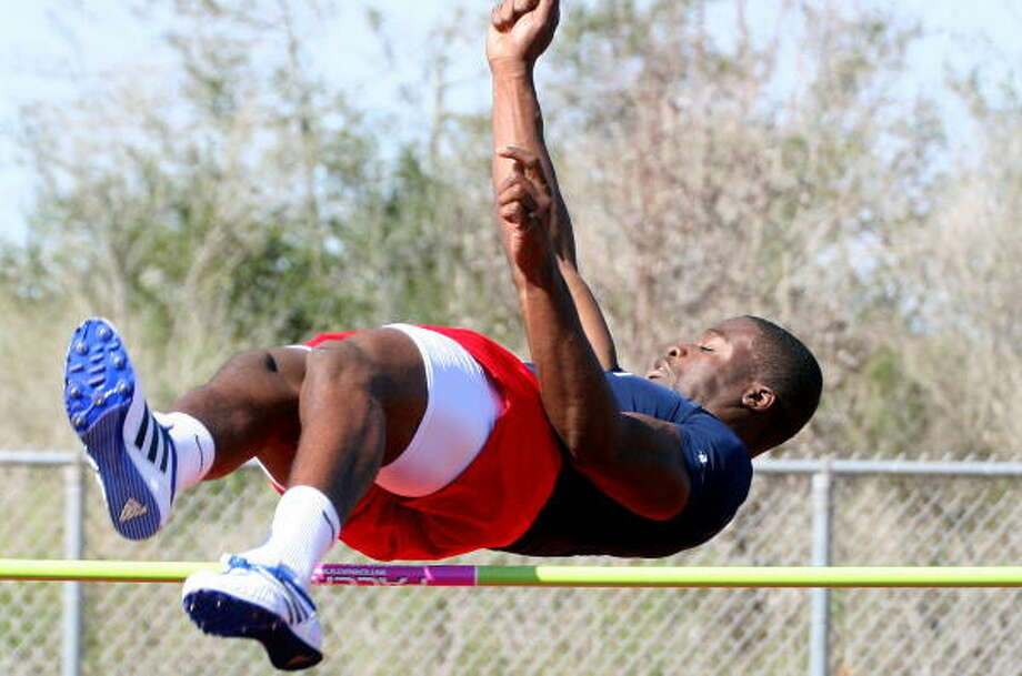 Taylor's Ajanku Damola clears the bar with ease in the high jump. Photo: Gerald James, For The Chronicle