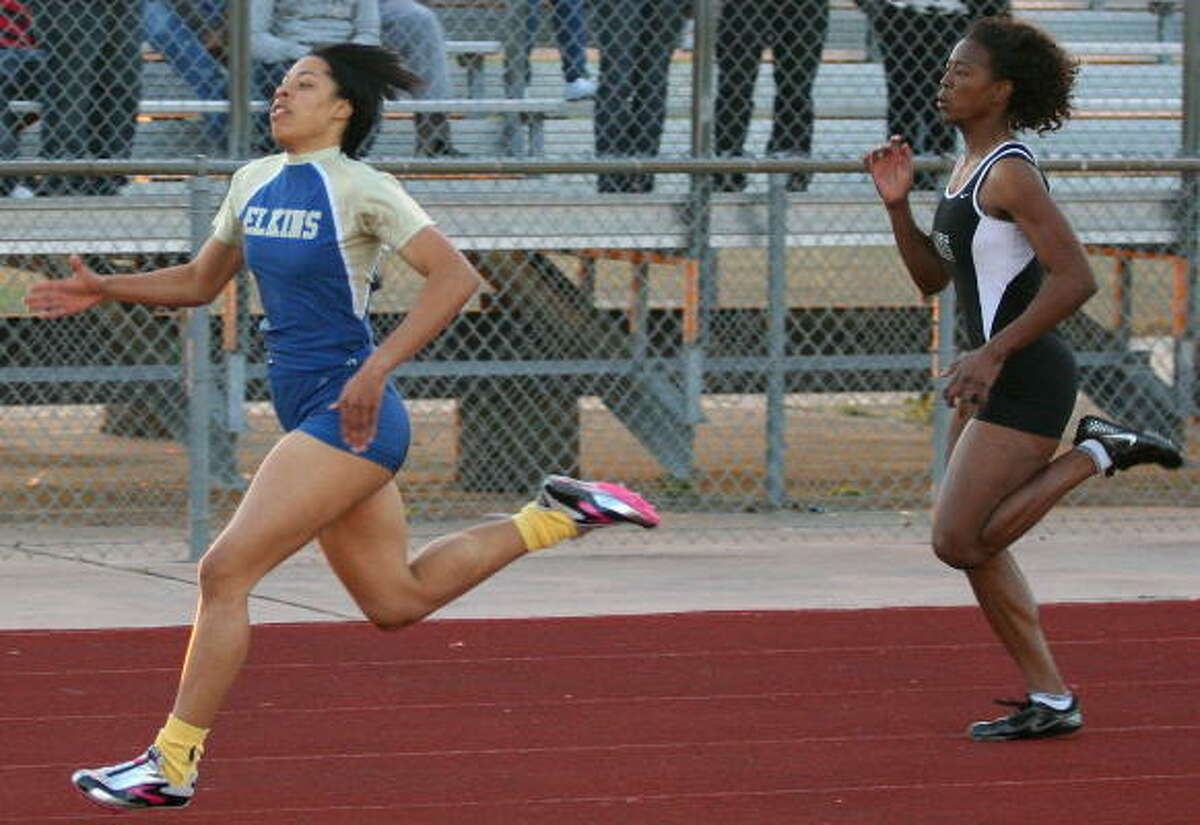 Elkins' Taylor Houston, left, takes first place while Mayde Creek's Craisha Washington wins second in the 200-meters.