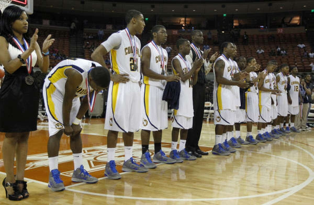 La Marque players line up to receive their second place medals after losing to Dallas Kimball.