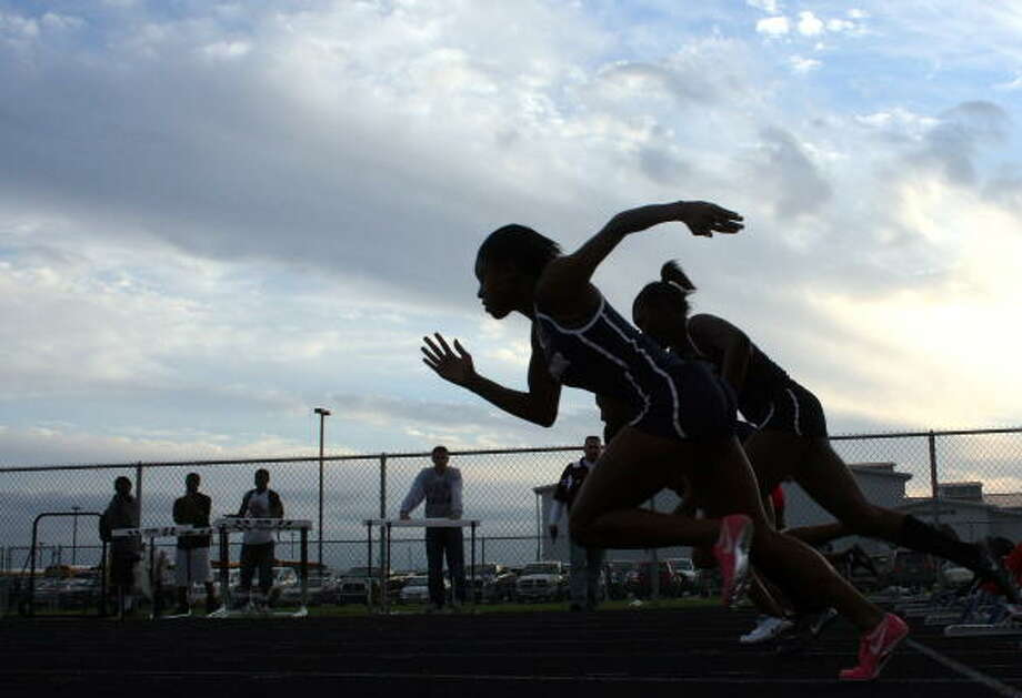 The sun sets on the 100-meter dash participants. Photo: Gerald James, For The Chronicle