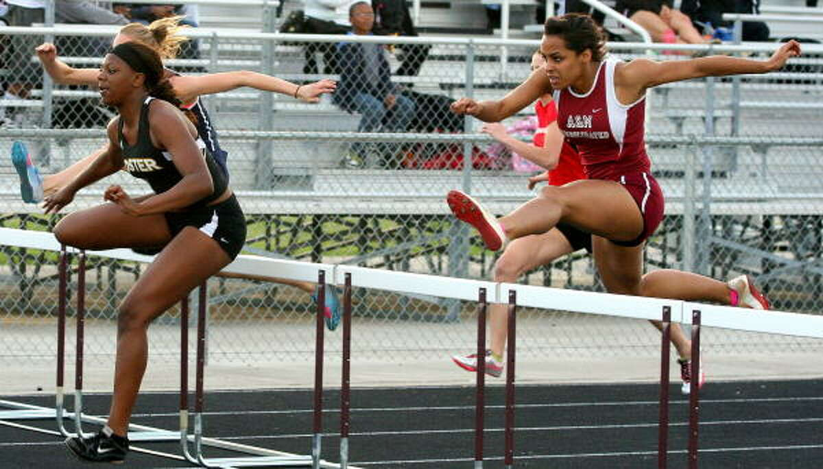 Foster's Erin Fairs, left, just edged A&M's Taylor Williams in the 100-meter dash with hurdles event.