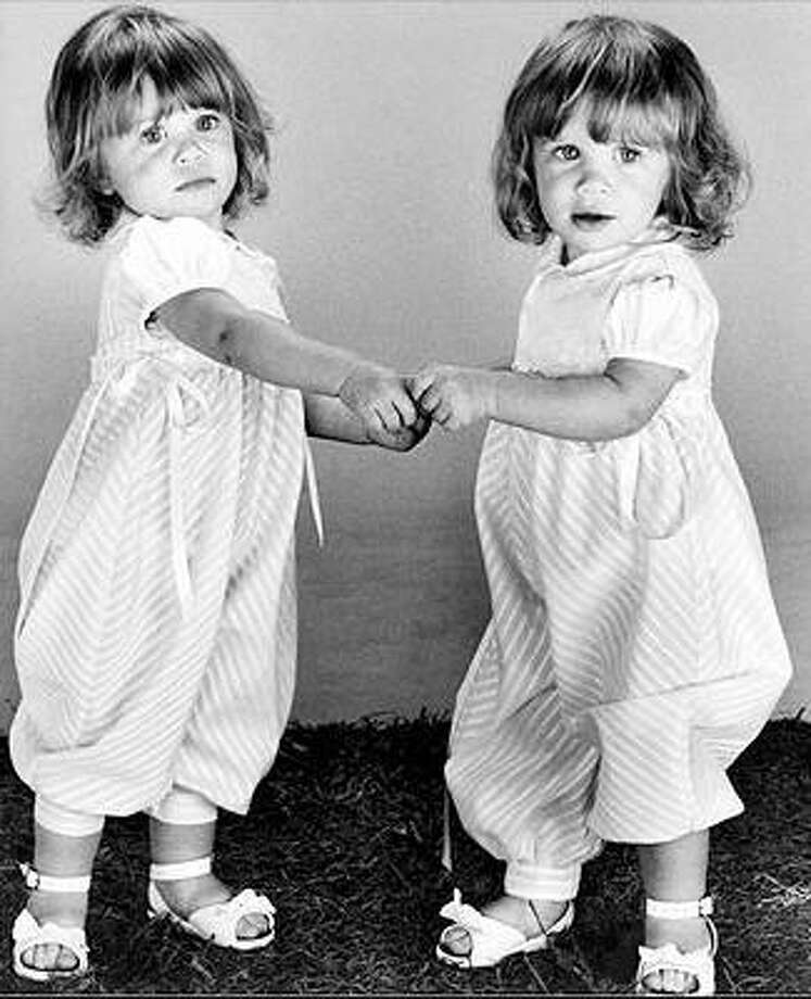 Mary-Kate and Ashley Olsen, 1987, age 1.  Full House; The Little Rascals; It Takes Two. Photo: AP