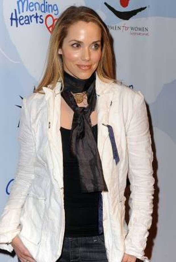 Elizabeth Berkley, 2010, age 38.  Women in Trouble; CSI: Miami; S. Darko. Photo: AP