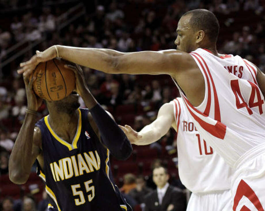 March 12: Rockets 112, Pacers 95Rockets center Chuck Hayes (44) blocks a shot by Indiana's Roy Hibbert during the first half of Saturday's game. Photo: Pat Sullivan, AP
