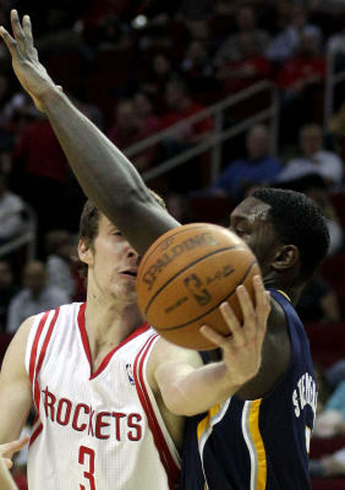 Rockets guard Goran Dragic, left, is fouled by Indiana's Lance Stephenson during the second half.