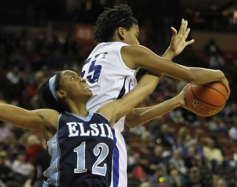 March 4: Georgetown 56, Elsik 51Elsik forward Akkuna Elonu, left, fails to haul in a rebound against Georgetown center Krystal Forthan during Friday's game. Photo: Erich Schlegel, For The Chronicle