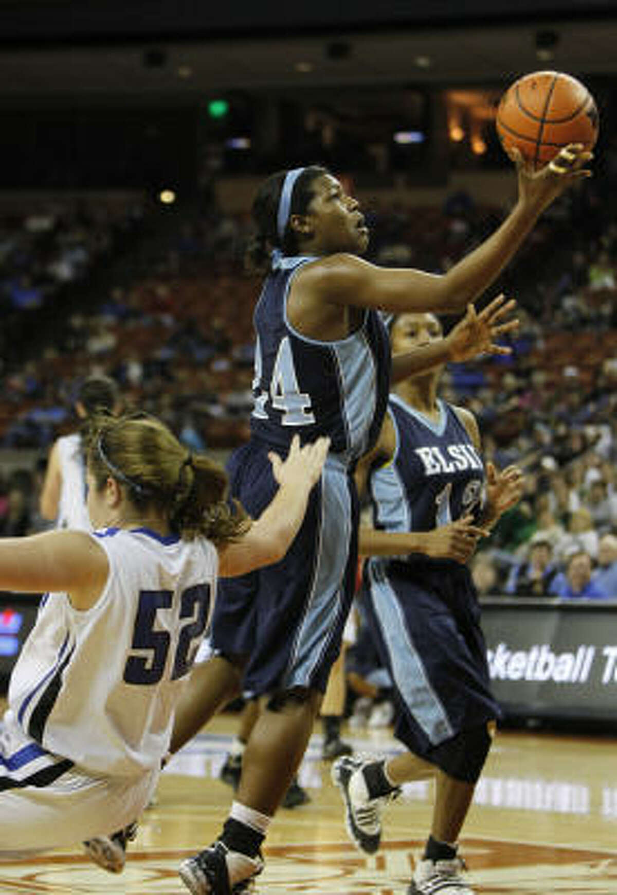 Elsik forward Crystal Porter shoots past a Georgetown player.
