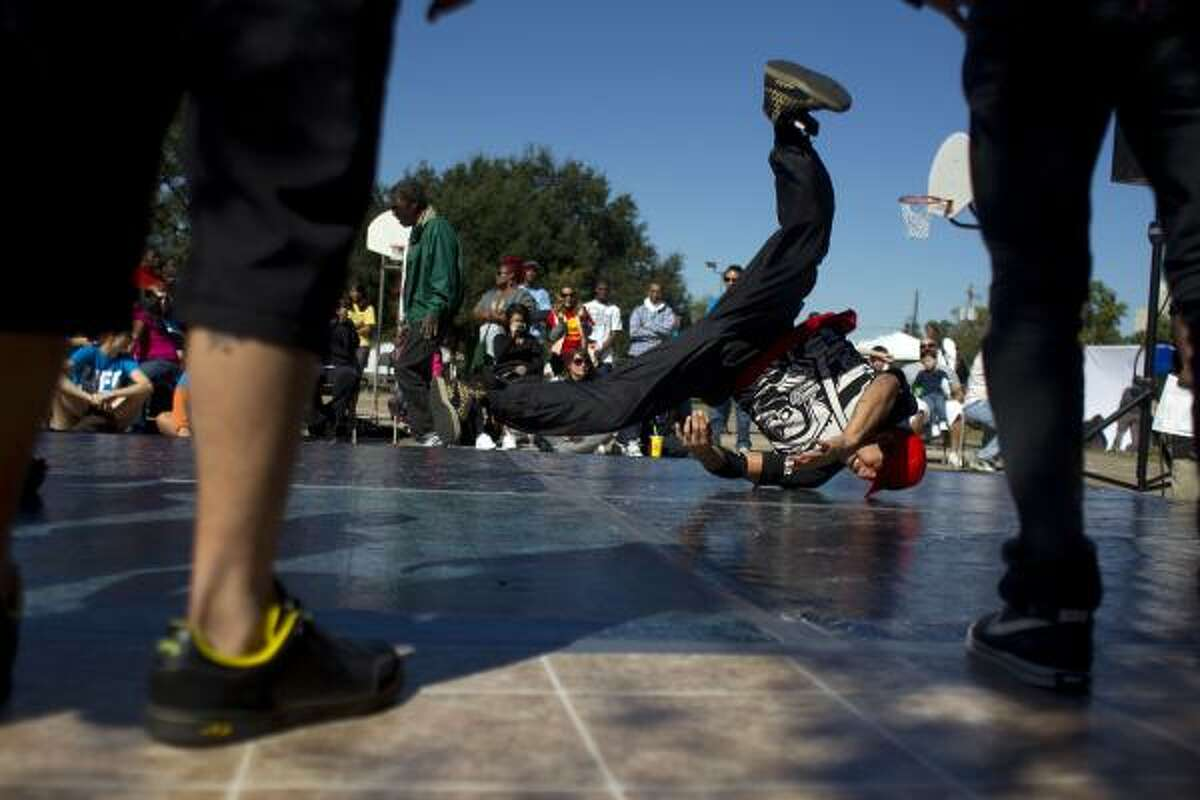 Break dancer, Leo Rodriguez, 23, with the group Youth Advocates performs during the hip-hop-based environmental justice festival Life is Living, put on by the University of Houston Cynthia Woods Mitchell Center for the Arts in partnership with the Living Word Project and Youth Speaks, Inc.