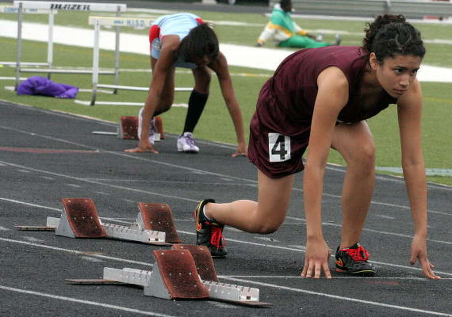Reagan's Jacqueline Torres gets set for heat 5 of the 200-meter run. Photo: Gerald James, For The Chronicle