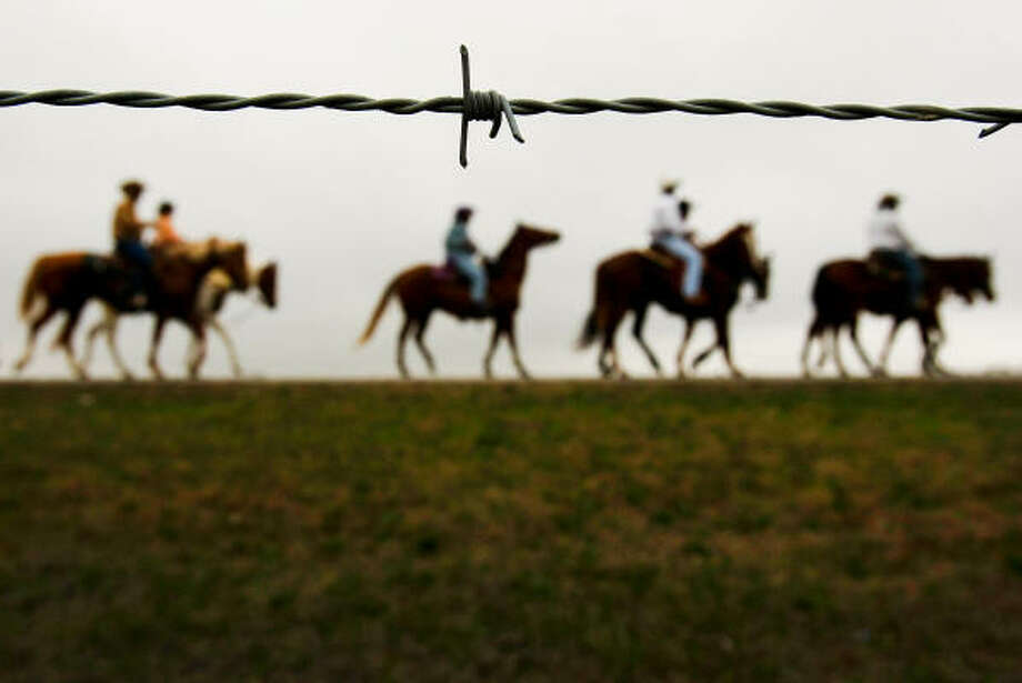 Headed for Houston for the annual rodeo parade, about 230 trail riders with the Southwest Trail Ride Association take off from Rosenberg Saturday, Feb. 19, 2011. Photo: Johnny Hanson, Houston Chronicle