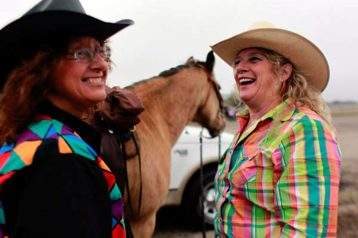 Joyce Monroe, right, who is on her 12th trail ride, shares a laugh with friend Deborah Grant who is on her 20th trail ride as they