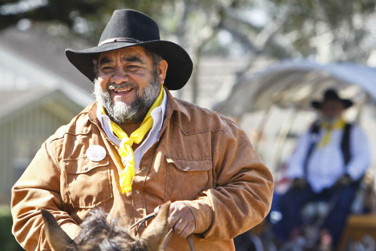 Sal Ramirez rides his horse along with fellow Southwestern Trail Riders as they make their way to Memorial Park.