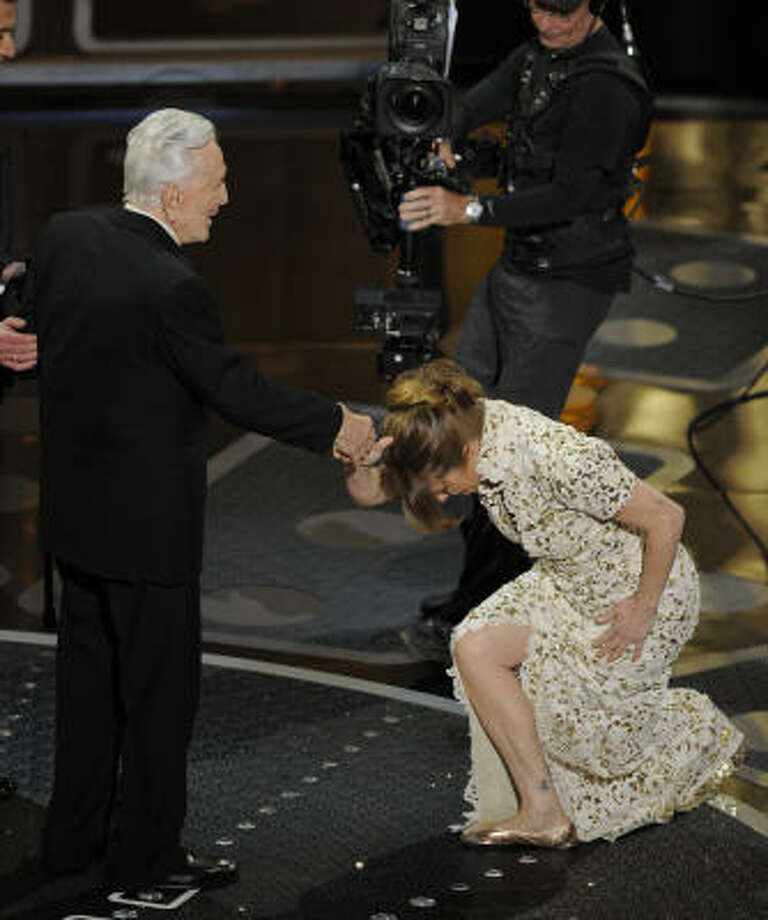 Melissa Leo bows to Kirk Douglass as she accepts the Oscar for best actress in a supporting role. Photo: Mark J. Terrill, AP