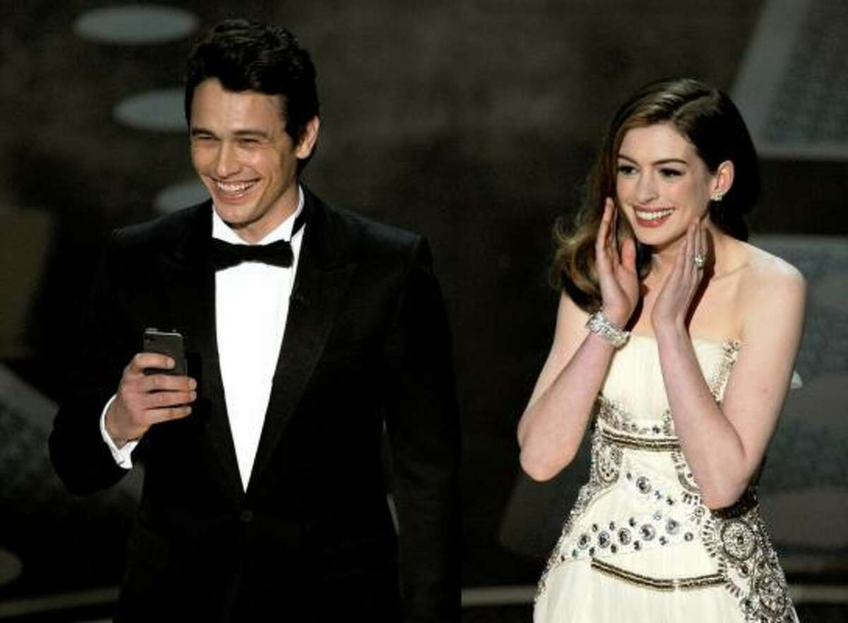 Hosts James Franco and Anne Hathaway.
