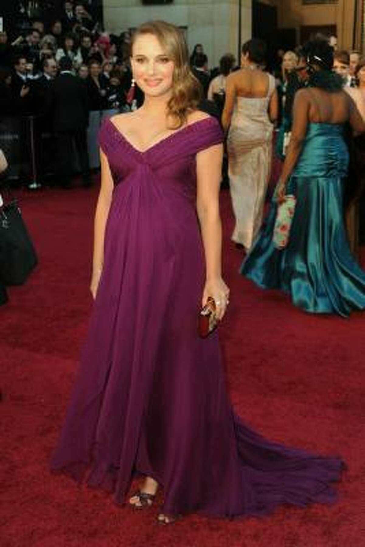Perhaps the only pregnant woman in human history who could pull off purple.