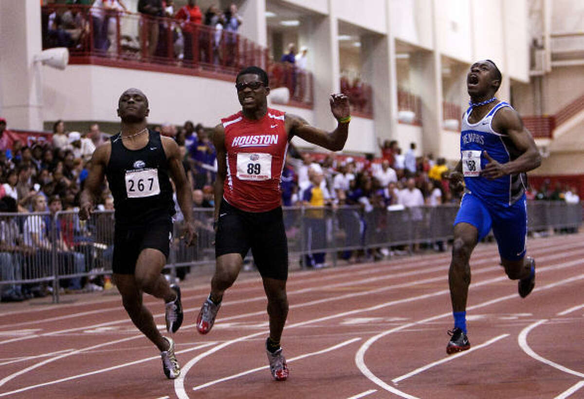 UH sprinter Errol Nolan (89) comes up with an injury at the finish line in the men's 60-meter.