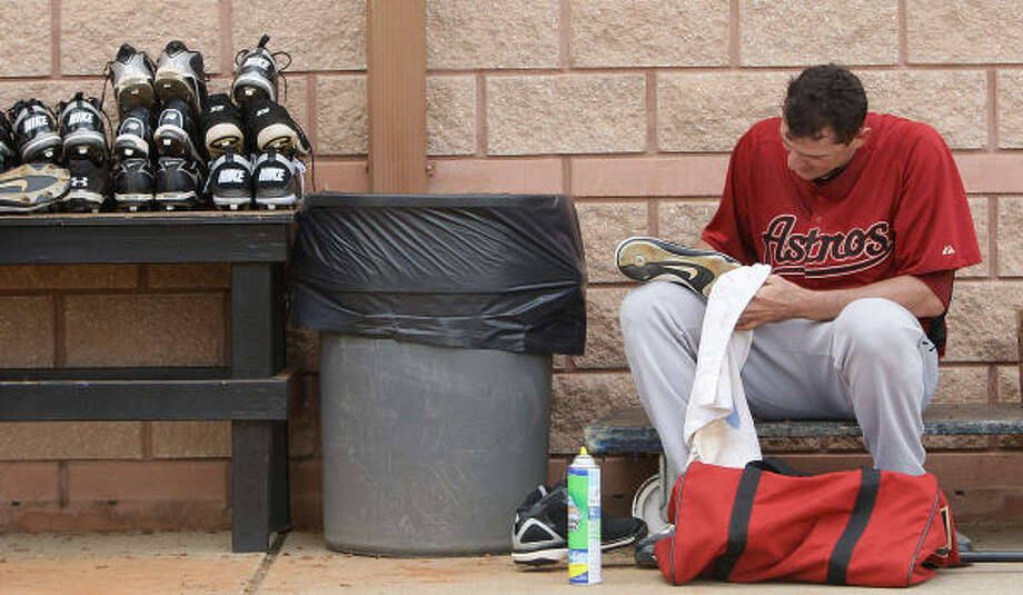 Astros LHP Douglas Arguello cleans his shoes after practice during spring training Friday in Kissimmee. Photo: Karen Warren, Chronicle