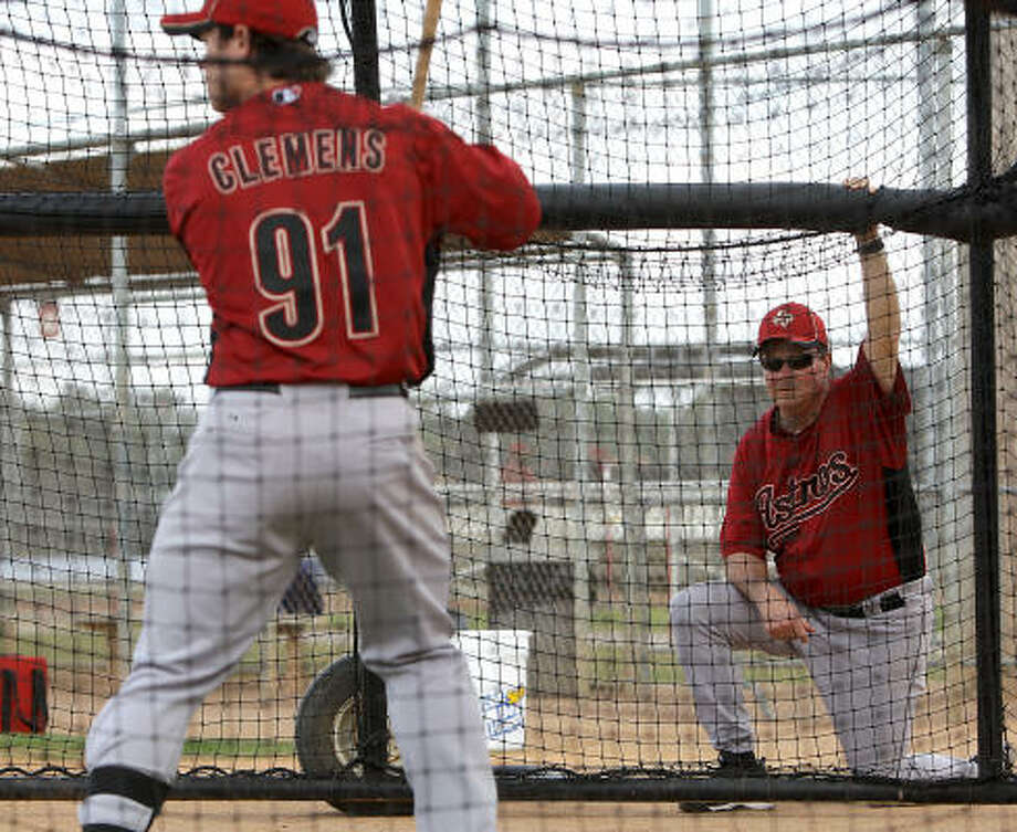 Astros hitting coach Mike Barnett watches Koby Clemens bat. Photo: Karen Warren, Chronicle