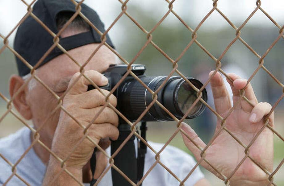 Astros fan Bill Howard takes a photo during spring training. Photo: Karen Warren, Chronicle