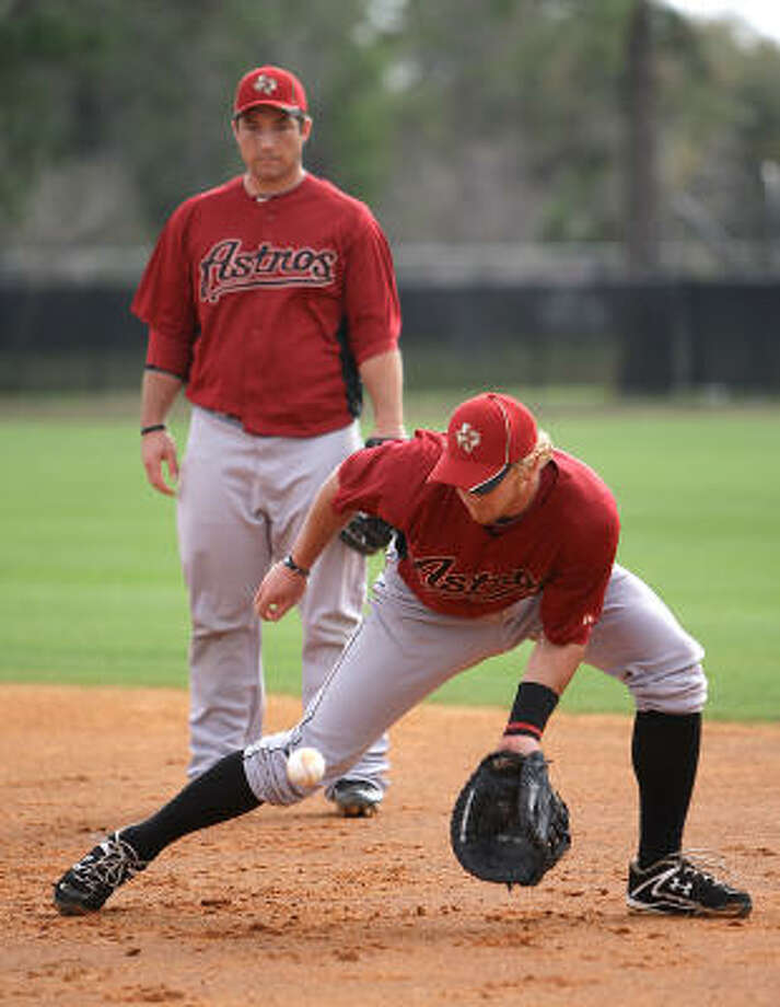 Astros catcher J.R. Towles fields a grounder during first base drills with Brett Wallace. Photo: Karen Warren, Chronicle