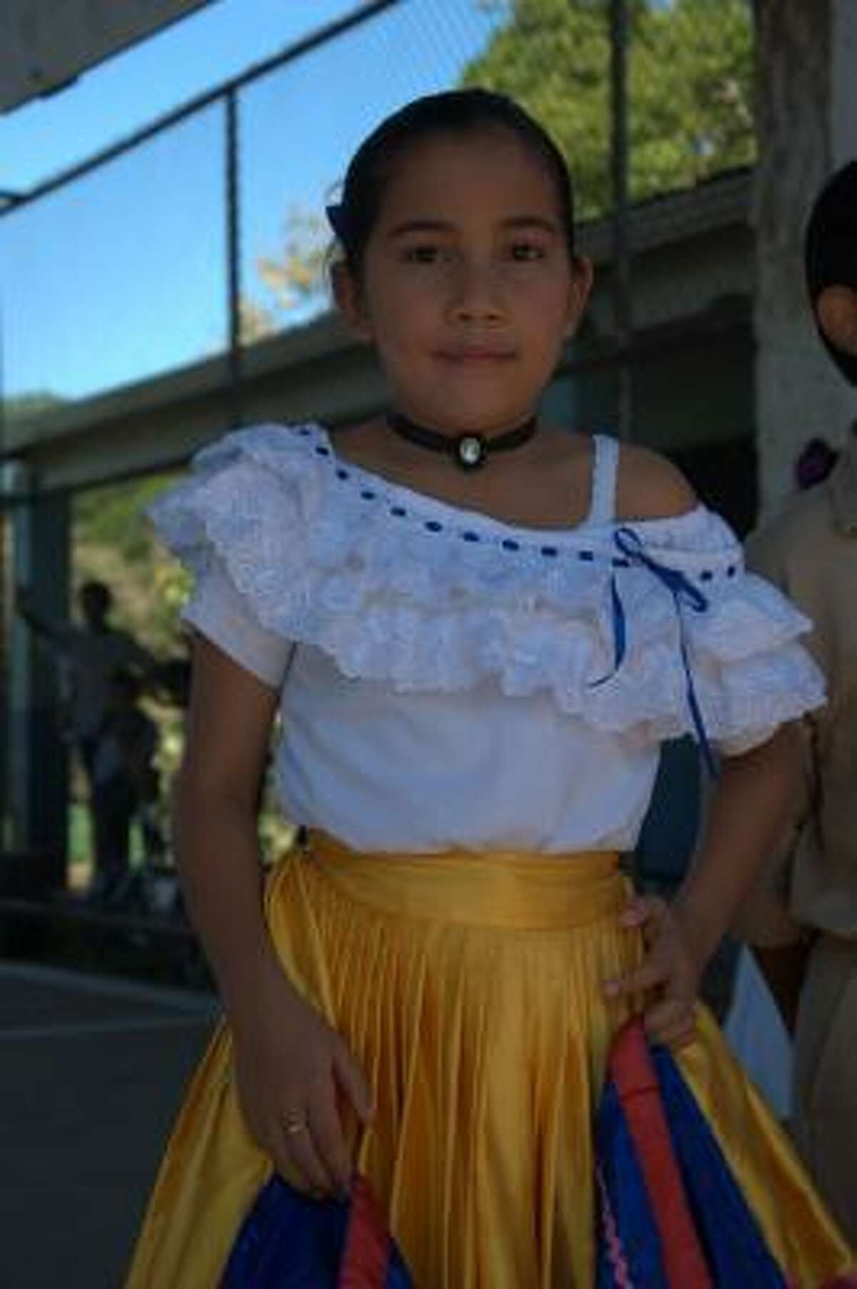 Maria Jose, 10, dances for visitors to her school in Costa Rica.