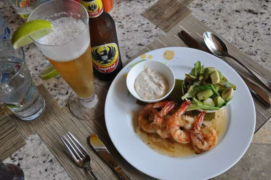 Shrimp and cerveza are favorites at Four Seasons Costa Rica's Papagayo restaurant. Photo: Melissa Ward Aguilar, Staff
