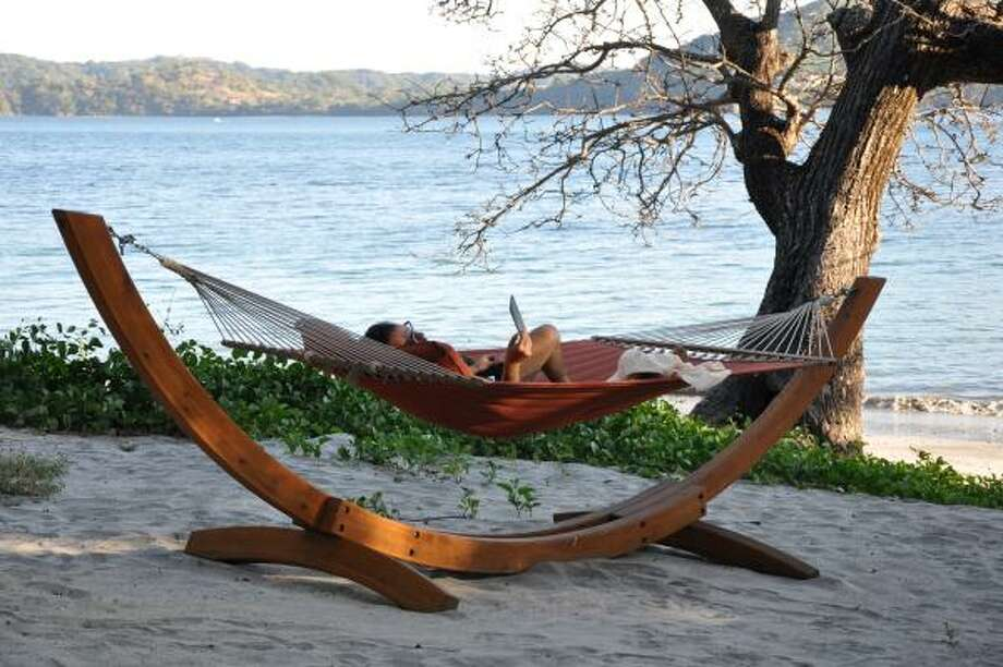 Gregg Lieberman relaxes on Playa Virador at the Four Seasons Costa Rica. Photo: Melissa Ward Aguilar, Staff