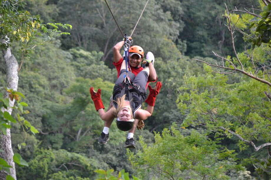 The guides at Witch's Rock Canopy Tour in Guanacaste, Costa Rica, will do whatever it takes to give visitors a thrill. Photo: Melissa Ward Aguilar, Staff
