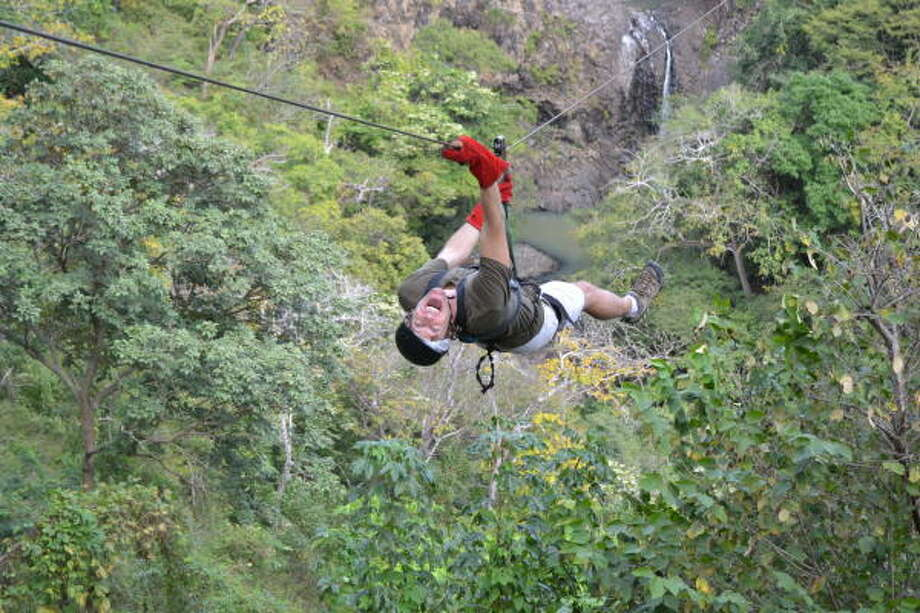 Zipline over a waterfall at Witch's Rock Canopy Tour in Guanacaste, Costa Rica. Photo: Melissa Ward Aguilar, Staff