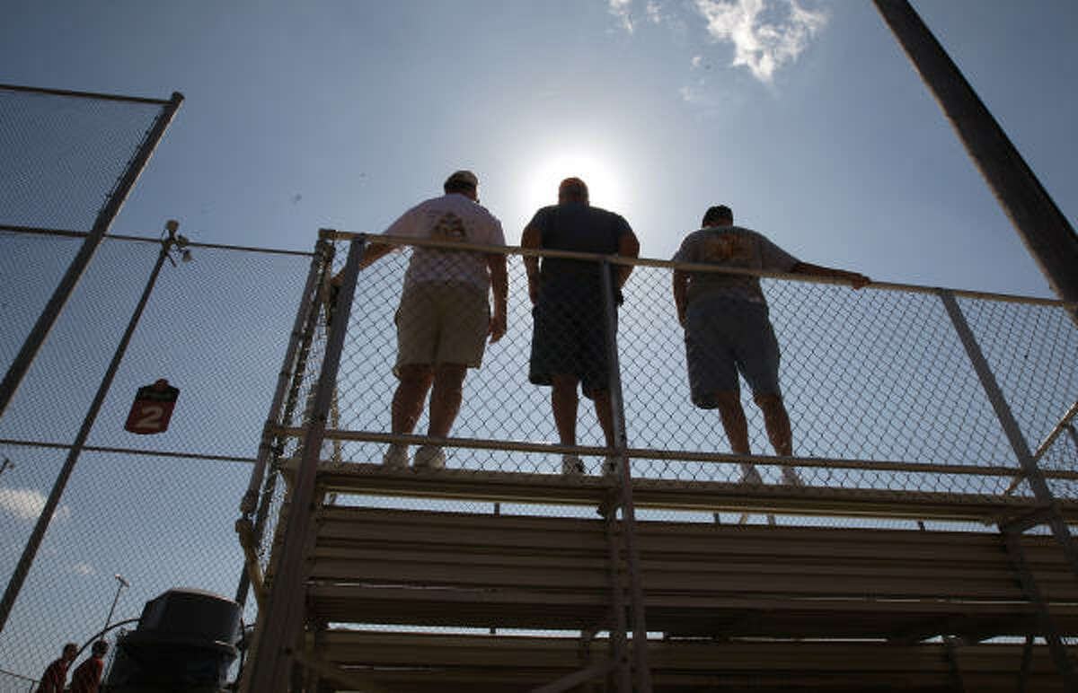 Fans stand on the top of the bleachers to watch live batting practice Tuesday in Kissimmee, Fla.