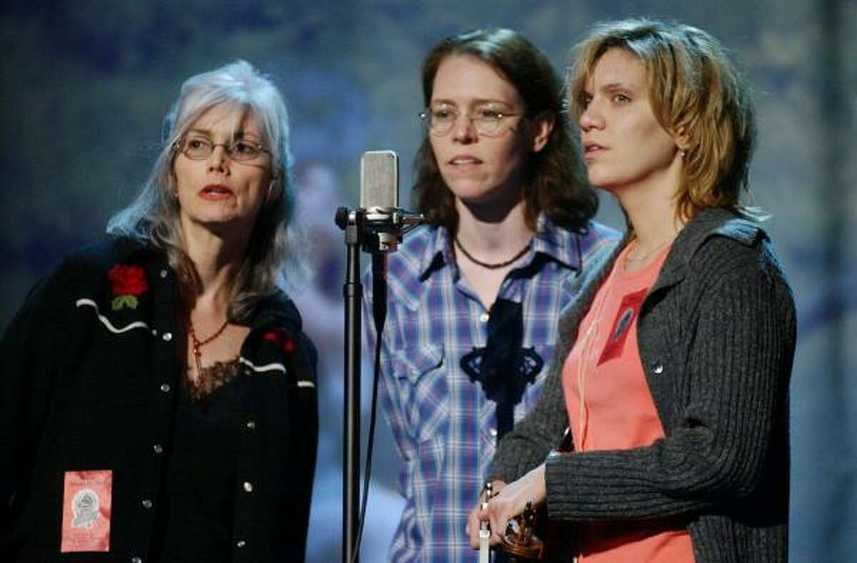 Before: They may have looked glamorous on an awards show night, but Emmylou Harris, left, Gillian Welch, center, and Alison Krauss looked a bit tired during rehearsal for the 44th Grammy Awards.