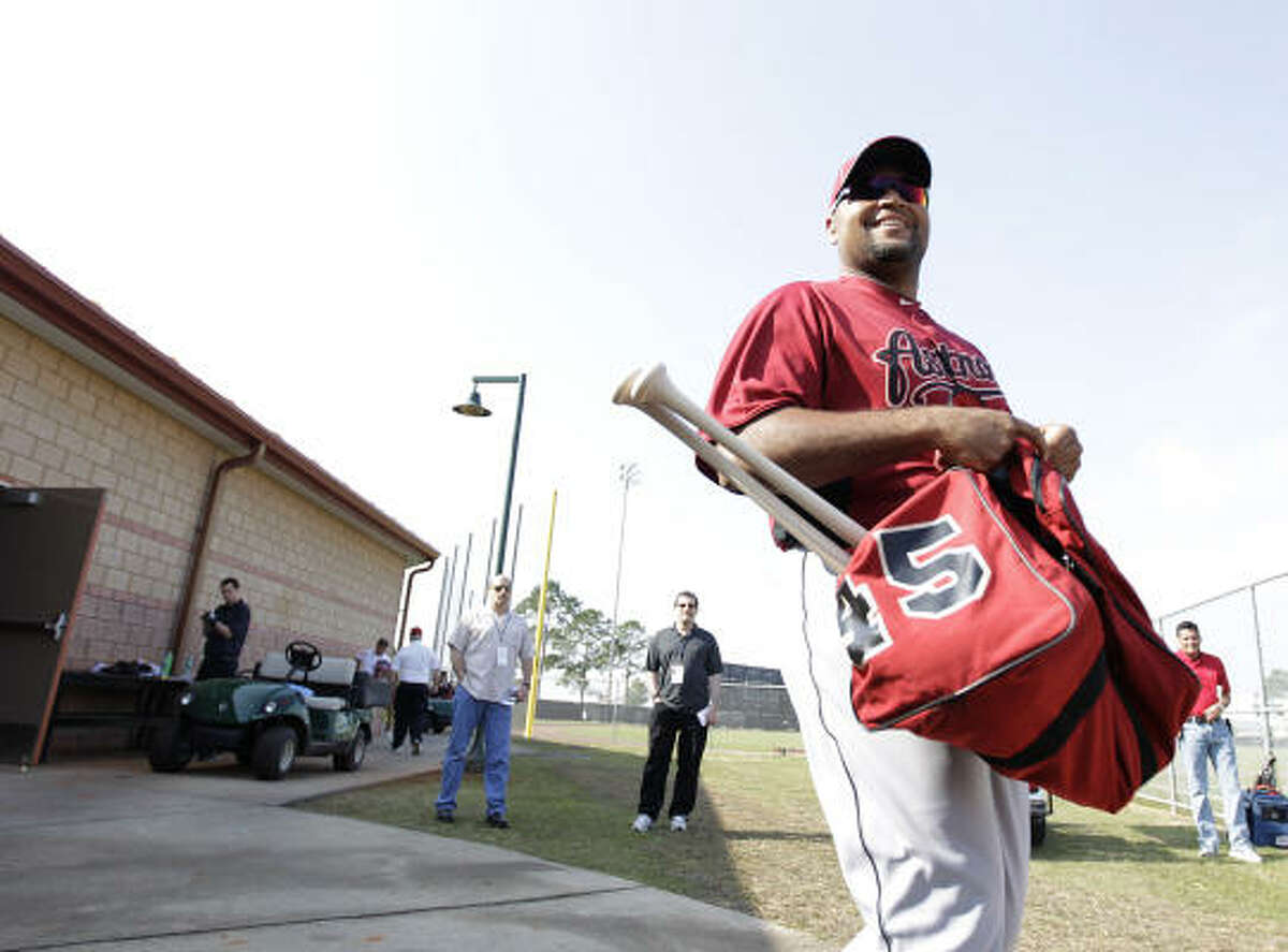 Astros outfielder Carlos Lee comes out of the clubhouse for the first day of full-squad workouts.