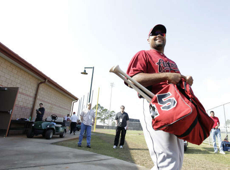 Astros outfielder Carlos Lee comes out of the clubhouse for the first day of full-squad workouts. Photo: Karen Warren, Chronicle
