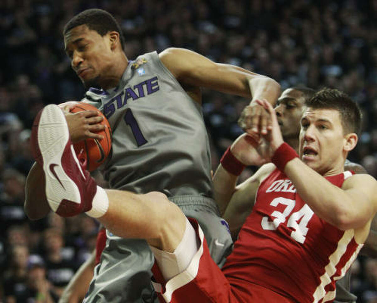 Kansas State 77, Oklahoma 62 Kansas State guard Shane Southwell (1) pulls down a rebound in front of Oklahoma guard Cade Davis (34) during the first half.