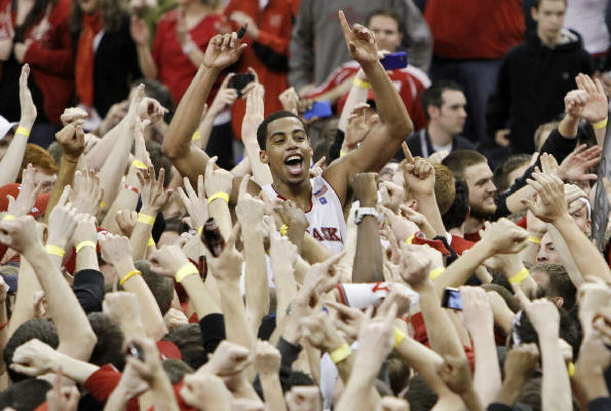 Feb. 19: Nebraska 70, No. 3 Texas 67 Nebraska's Toney McCray is carried on the shoulders of fans who stormed the court after the Cornhuskers upset the Longhorns on Saturday in Lincoln.