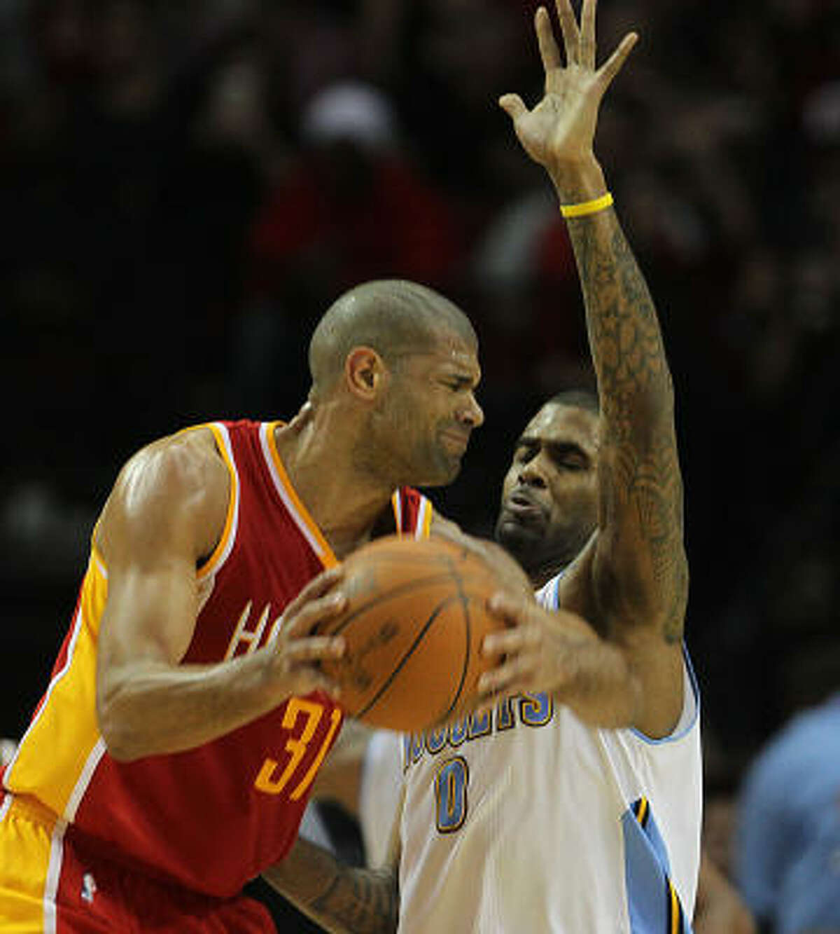 Rockets forward Shane Battier, left, tries to move past Nuggets guard Gary Forbes, right.