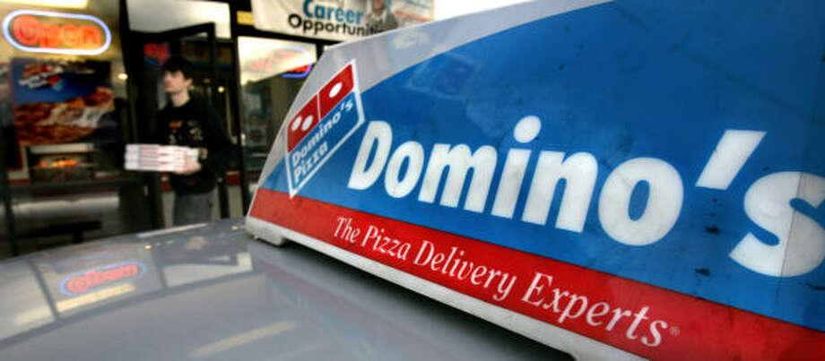 Domino's PizzaFounder Tom Monaghan is a Roman Catholic who donates to Catholic charities and has set up organizations for Catholic education and Catholic businessmen. Photo: Douglas C. Pizac, ASSOCIATED PRESS