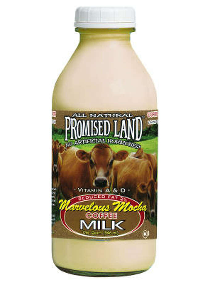 """Promised Land DairyThe Texas creamery quotes Deuteronomy 26:9 on its website: """"He brought us to this place and gave us this land, a land flowing with milk and honey"""" Photo: Chronicle File"""