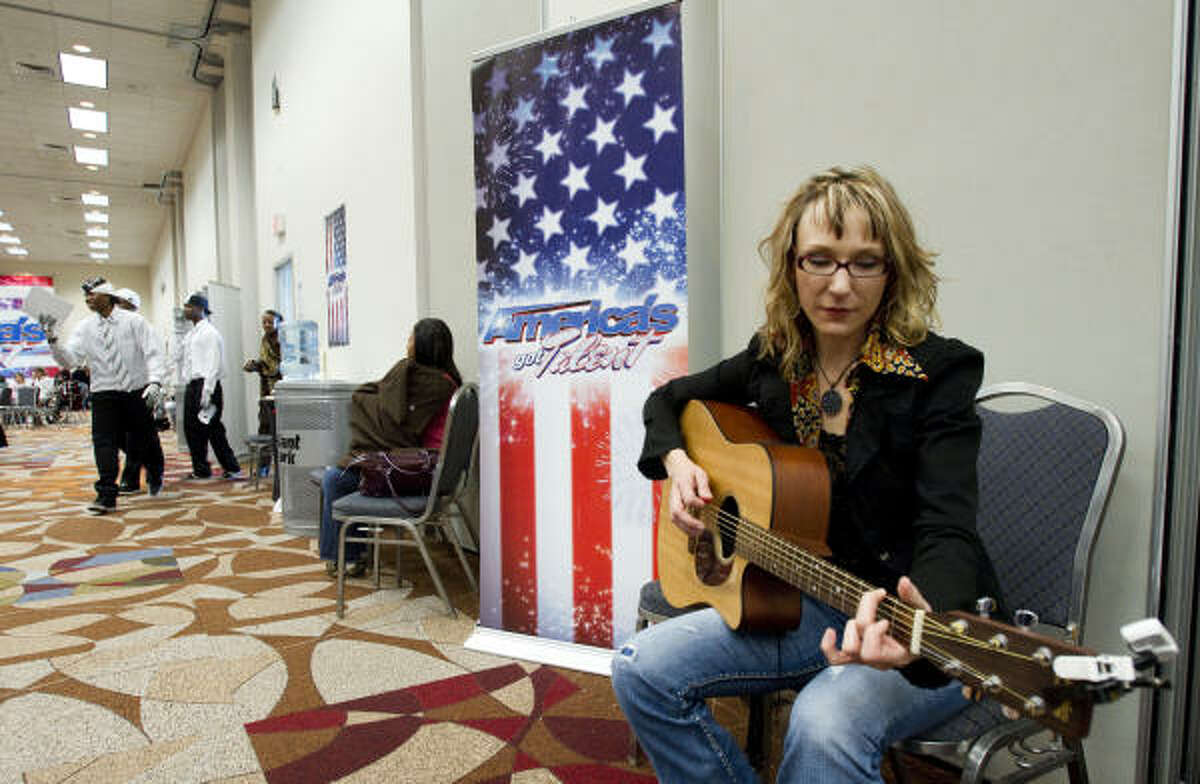 Season Ammons, of Houston, hopes her guitar is her ticket to fame.