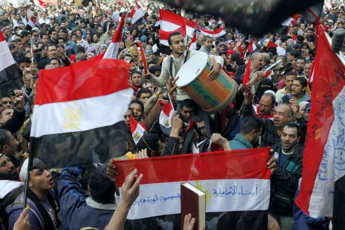 Egyptians dance and wave national flags in Tahrir Square in Cairo, Egypt.