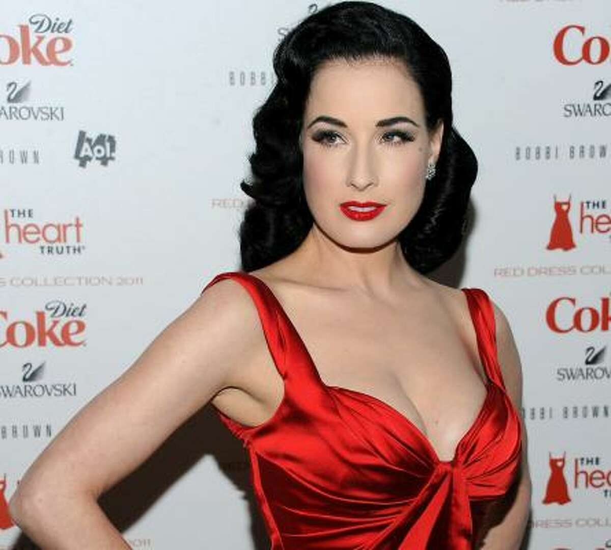 This satiny number by Zac Posen fits Dita Von Teese's classic pinup look. Her lips are the perfect red, as always.