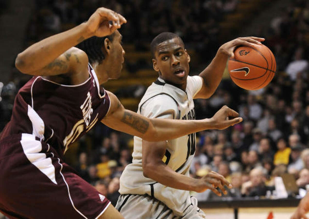 Feb. 10: No. 22 Texas A&M 73, Colorado 70 (OT) Texas A&M forward David Loubeau, left, pressures Colorado guard Alec Burks during the second half of Wednesday's game in Denver. The Aggies rallied to beat Colorado in overtime and improve to 18-5.