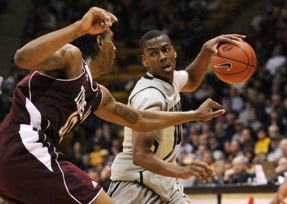 Feb. 10: No. 22 Texas A&M 73, Colorado 70 (OT) Texas A&M forward David Loubeau, left, pressures Colorado guard Alec Burks during the second half of Wednesday's game in Denver. The Aggies rallied to beat Colorado in overtime and improve to 18-5. Photo: Jack Dempsey, AP