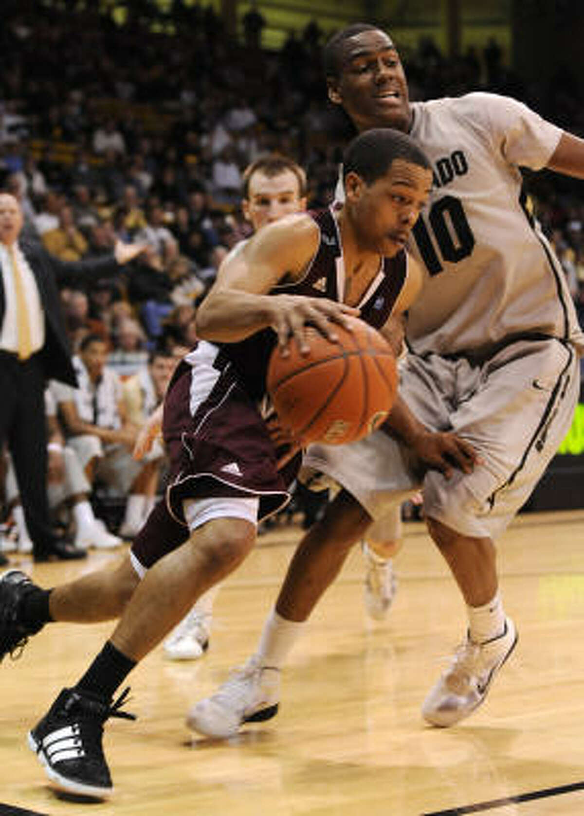 Texas A&M guard B.J. Holmes drives past Colorado guard Alec Burks (10) during overtime. Holmes finished with 13 points.