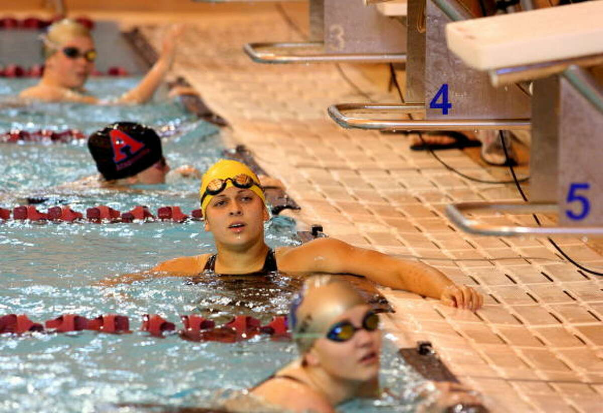 Lufkin's Sophia Humphrey checks the scoreboard to see her results of the 100-yard butterfly swim.