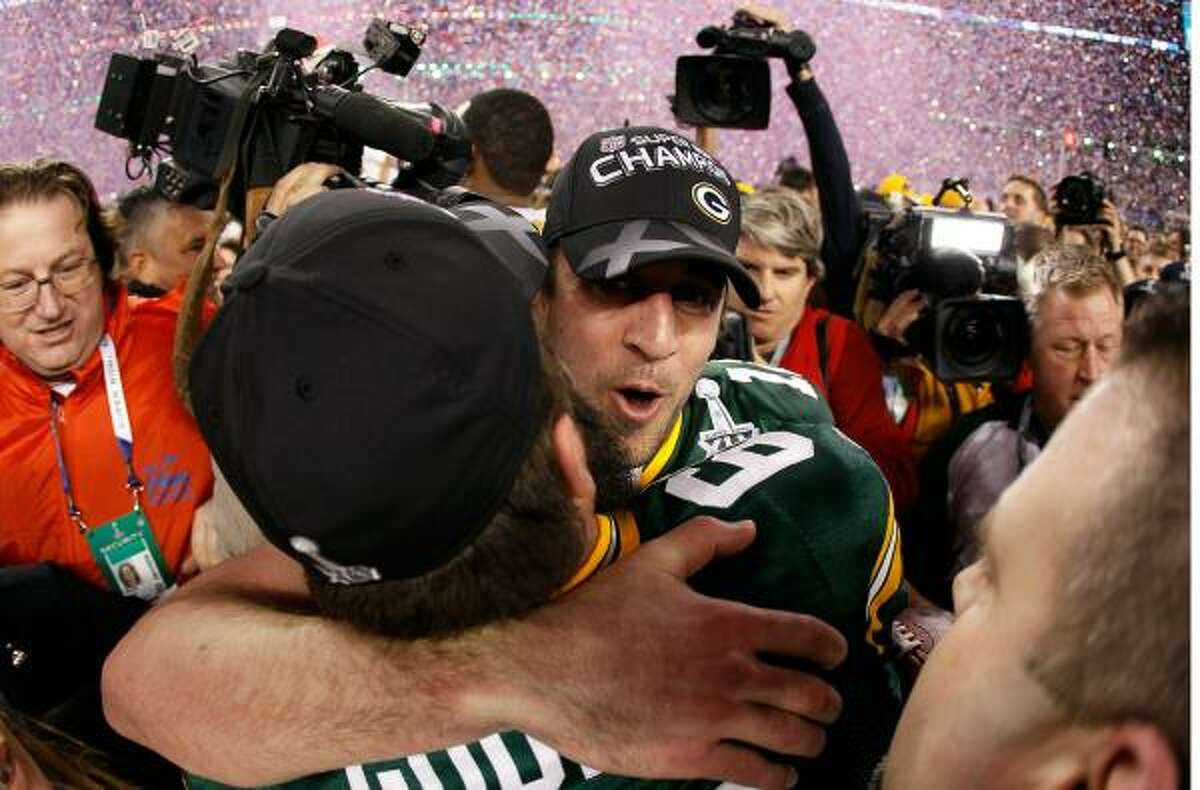 Packers quarterback Aaron Rodgers, rear, hugs teammate Brett Goode after their win over the Steelers in Super Bowl XLV.