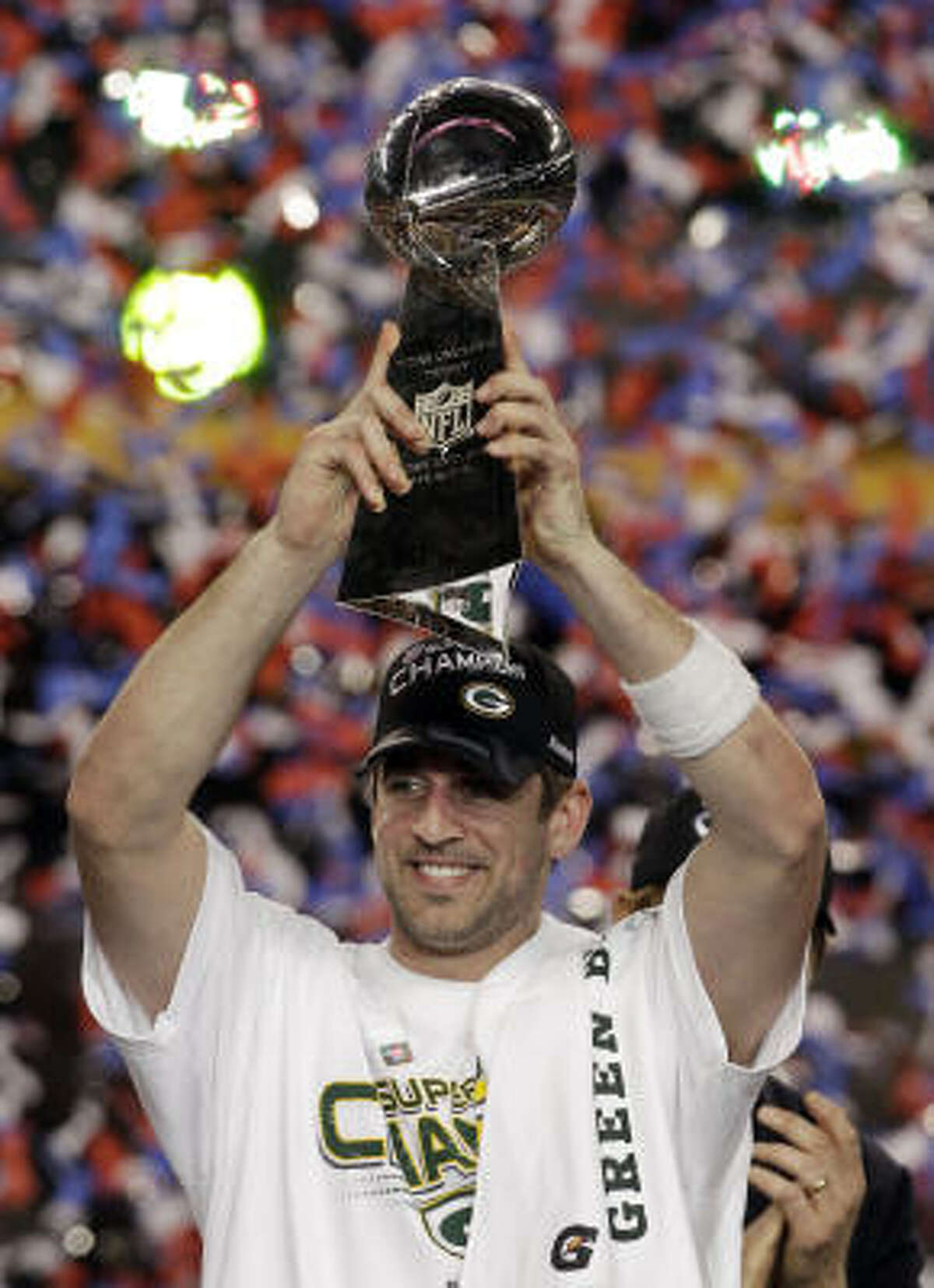 Packers quarterback Aaron Rodgers poses with the Vince Lombardi Trophy after Sunday's win.