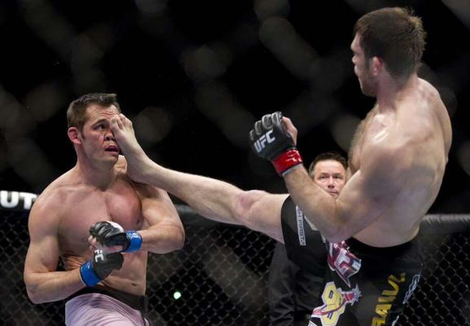 Forrest Griffin, right, lands a kick against Rich Franklin during the second round. Photo: Julie Jacobson, AP